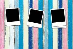 Fotos en blanco en la madera en colores pastel de la pintura Imagen de archivo