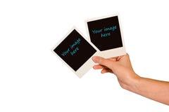 Fotos en una mano Imagen de archivo libre de regalías