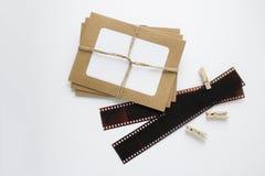 Fotos llenas en un marco y una película Fotografía de archivo