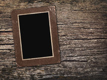 Fotos viejas del vintage en un fondo de madera Imagen de archivo libre de regalías