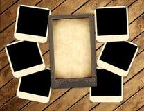 Fotos viejas en el tablero de madera Fotografía de archivo