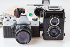 Fotos y cámaras viejas Foto de archivo libre de regalías
