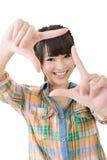 Fotozeichen gemacht durch Hände der asiatischen Frau Stockfotos