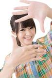 Fotozeichen gemacht durch Hände der asiatischen Frau Lizenzfreie Stockfotografie