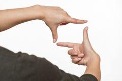 Fotozeichen gemacht durch menschliche Hände auf weißem Hintergrund Stockfoto