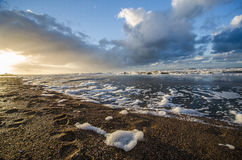 Fotspår i sanden på stranden av Norderney Royaltyfri Foto
