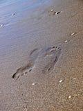 Fotspår på sanden Arkivbild