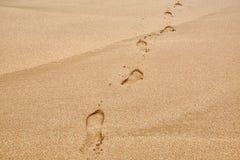 Fotsteg i sand Arkivbilder