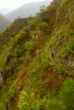 Fotvandra incaen skuggar överskriften till Machu Picchu Royaltyfri Foto