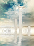 Fou ruined columns in Greek Ionian style in water Stock Photos