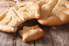 Fougasse French bread with sesame seeds and herbs closeup. Horiz Stock Images