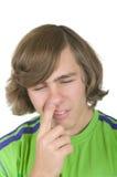 Fouilles d'adolescent dans un nez Images libres de droits