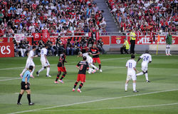 Foul_Soccer Players_ Football Fans_Photographers. Portuguese winger player Fabio Coentrao seeks to avoid Maxi Pereira foul at Light Stadium (or Estadio da Luz) Stock Images