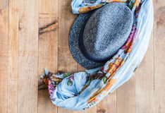 Foulard and hat on wooden. Table Stock Photo