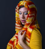 Foulard. An image of a girl with a yellow foulard in her head Royalty Free Stock Image
