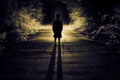 Found. A child stands before an unidentified light Stock Photos
