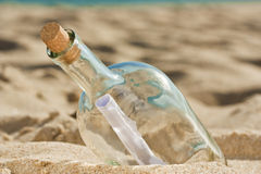 Found a bottle with a message near the shore Royalty Free Stock Photography