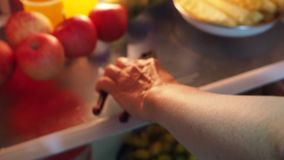 Found a nail clipper in the refrigerator. Feeling unusual and wondering if people who do this may be Alzheimer`s disease stock footage
