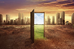 Found new world with green environment from open wooden door Royalty Free Stock Photography