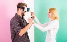 Found out how to teach him dance. Virtual reality dance school. Man vr glasses dancing with happy smiling girl. Learn. Movement from cyber teacher in virtual Stock Photos