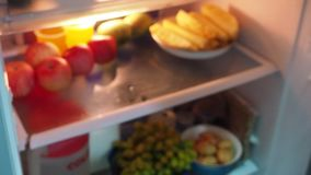 Found a plier in the refrigerator. Found a pliers in the refrigerator. Feeling unusual and wondering if people who do this may be Alzheimer`s disease stock video