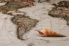 Found shell, map and travel Royalty Free Stock Photography