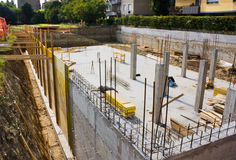 Foundation. Excavation and foundation for the construction of a building - masonry work Stock Image