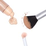 Foundation, concealer pencil and powder with makeup brush Royalty Free Stock Image