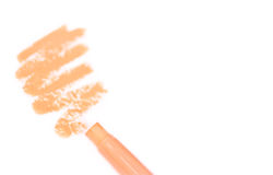 Foundation/concealer pencil with stroke on white Royalty Free Stock Photo