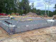 Foundation. Construction of concrete slab showing re-bars, granite under slab and foundation wall Stock Images