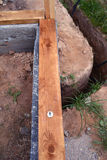 Foundation construction with wooden plank, anchor and trench Stock Images