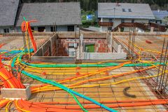 Foundation construction with yellow, orange, pvc tubes. Foundation construction with yellow plastic tubes, construction site in city stock image