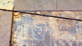 Foundation Crack Bisecting Tile Royalty Free Stock Images
