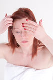 Foundation cream. A woman applying foundation to her face Royalty Free Stock Photos