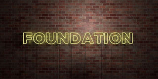 FOUNDATION - fluorescent Neon tube Sign on brickwork - Front view - 3D rendered royalty free stock picture. Can be used for online banner ads and direct Royalty Free Stock Photo
