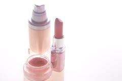 Foundation, lipstick and blush. On white Stock Photos