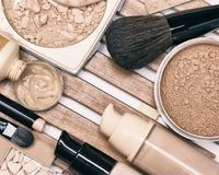 Foundation makeup products with professional brushes Stock Photography