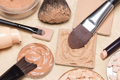 Foundation makeup products on crumpled paper royalty free stock photography