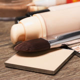 Foundation makeup products with makeup brush. Close-up of foundation makeup products with makeup brush Royalty Free Stock Photos