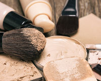 Foundation makeup products with sponge and brushes Stock Photography