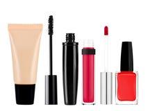 Foundation, mascara, lip gloss and nail polish isolated on white. Background Royalty Free Stock Photography