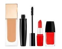 Foundation, mascara, lipstick and nail polish isolated on white Stock Photos