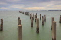Foundation piles into the sea. Stock Photography