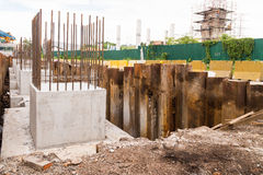 Foundation, pillar and beam being constructed at construction site.  Stock Photography