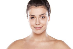 Only foundation. Portrait of a smiling young woman just with foundation on her face Stock Photography