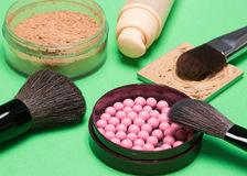 Foundation, powder, blush with makeup brushes Stock Photography