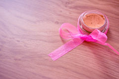 Foundation product with decorative pink ribbon Royalty Free Stock Image