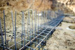 Foundation site of new building, details and reinforcements with steel bars and wire rod Royalty Free Stock Image