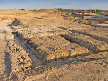Foundations for a new home. Looking across cleared land ready for a housing development with footings for a new house in the foreground royalty free stock images