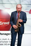 Founder of IDS Scheer software company professor Scheer playing saxophone Royalty Free Stock Photos